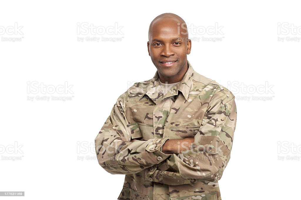 Portrait of happy American African soldier with arms crossed stock photo
