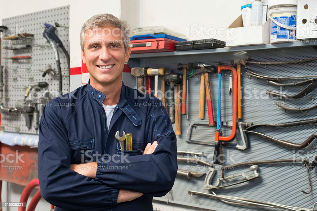 Portrait Of Happy Auto Mechanic stock photo
