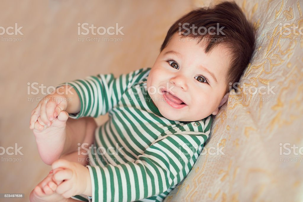 Portrait of happy beautiful baby stock photo