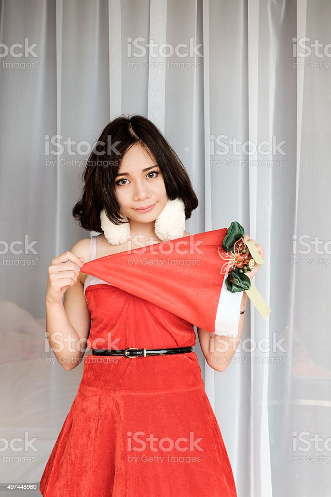 Portrait of Happy beautiful girl wearing Santa Claus clothes stock photo