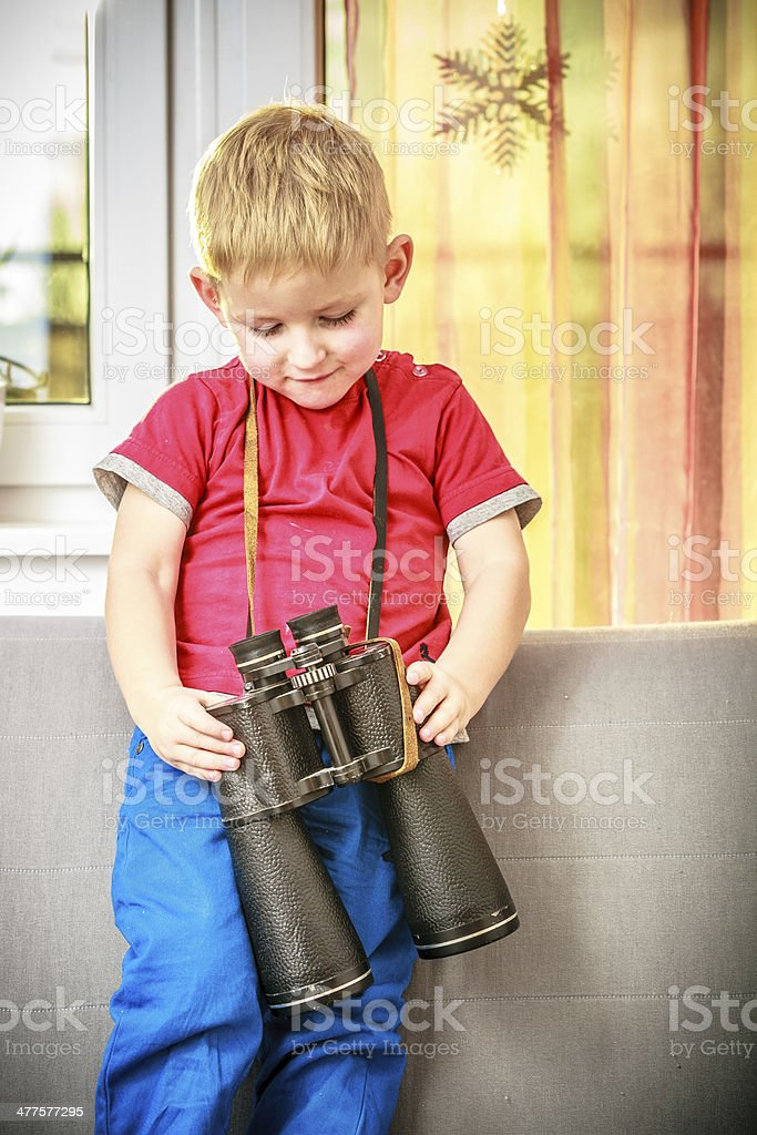 Portrait of happy boy child kid playing with binoculars royalty-free stock photo