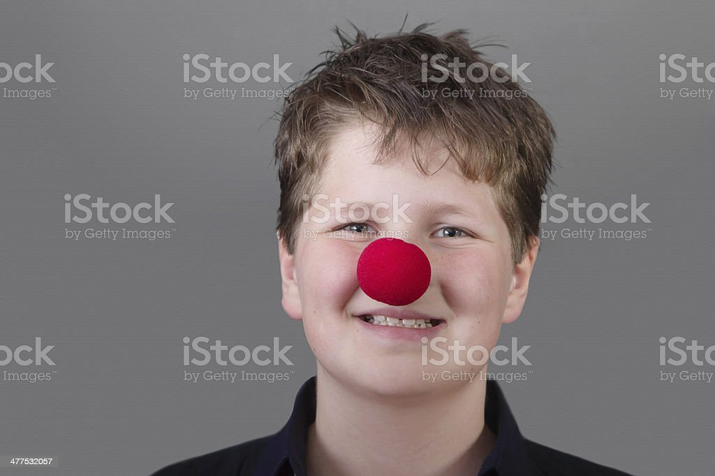 Portrait of happy boy with red nose stock photo