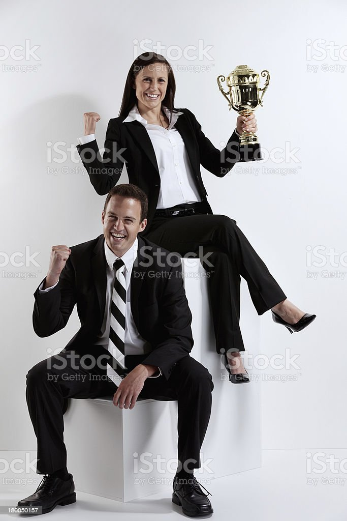 Portrait of happy business couple with trophy royalty-free stock photo