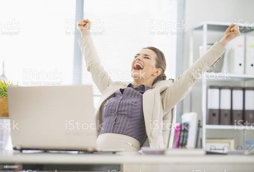 portrait of happy business woman in office rejoicing success stock photo
