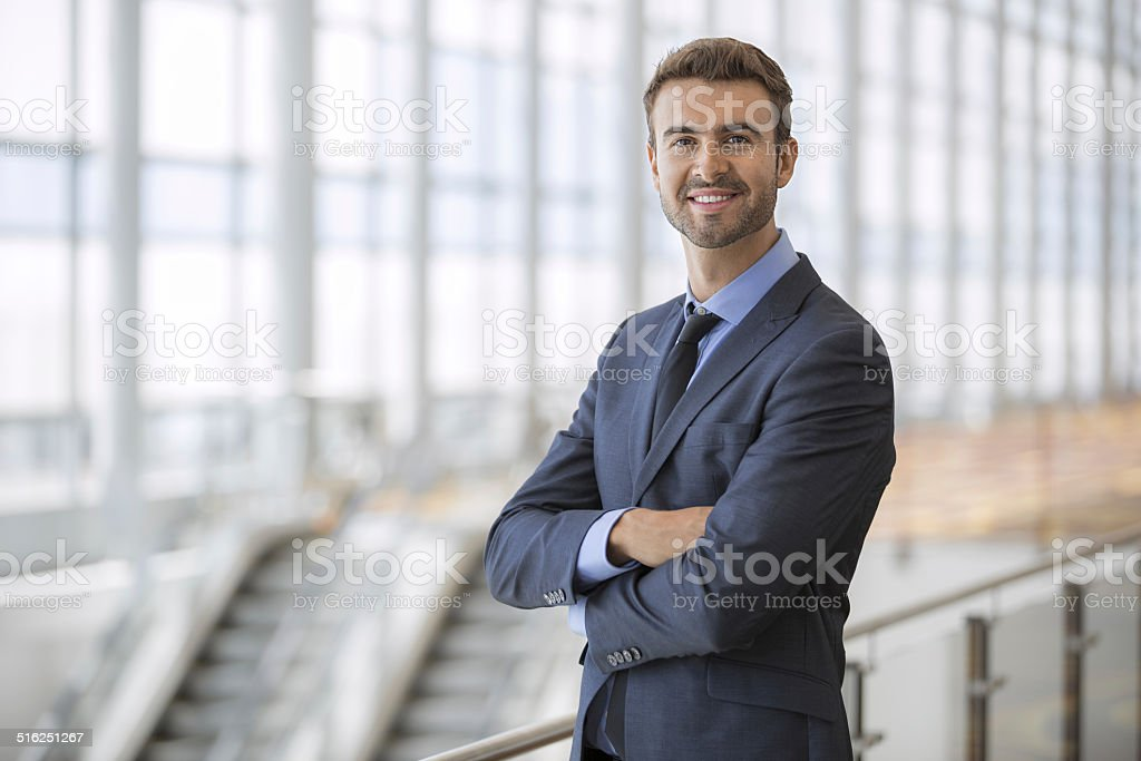 Portrait of happy businessman inside an airport terminal stock photo