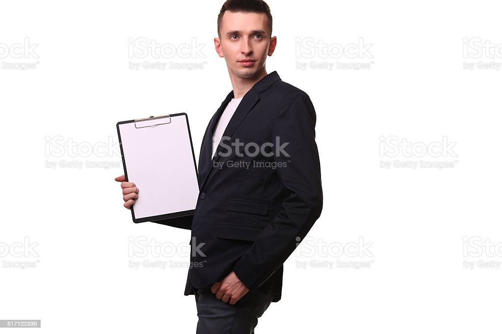 Portrait of happy businessman showing blank clipboard over white royalty-free stock photo