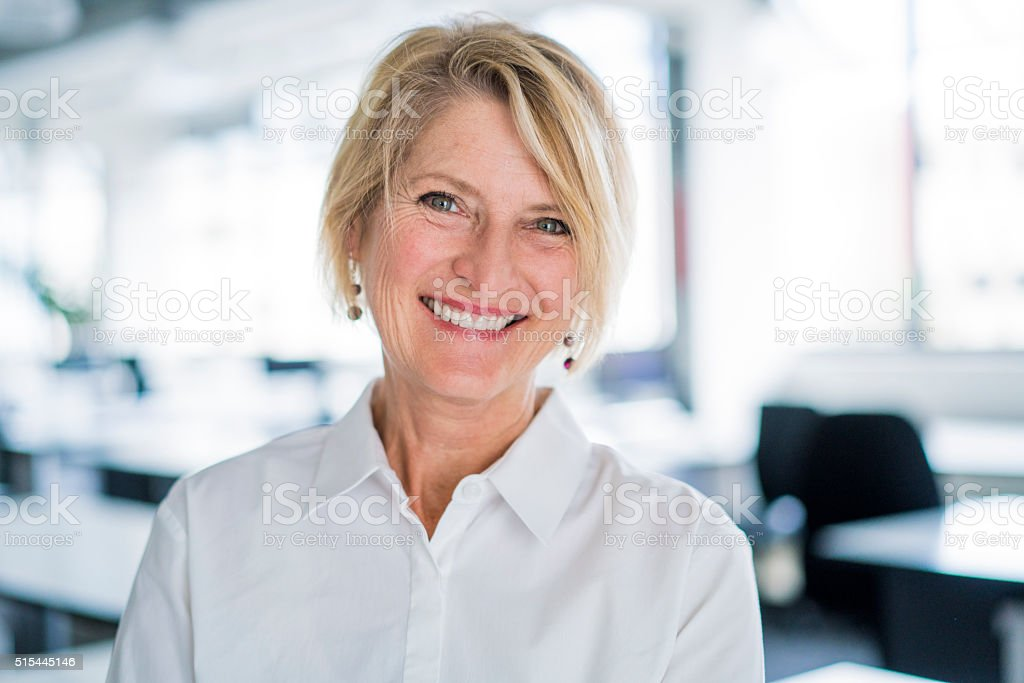 Portrait of happy businesswoman in office stock photo