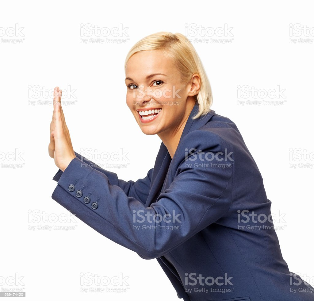 Portrait Of Happy Businesswoman Pushing Invisible Wall stock photo