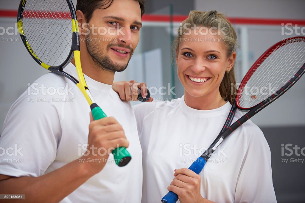 Portrait of happy couple after combined match stock photo