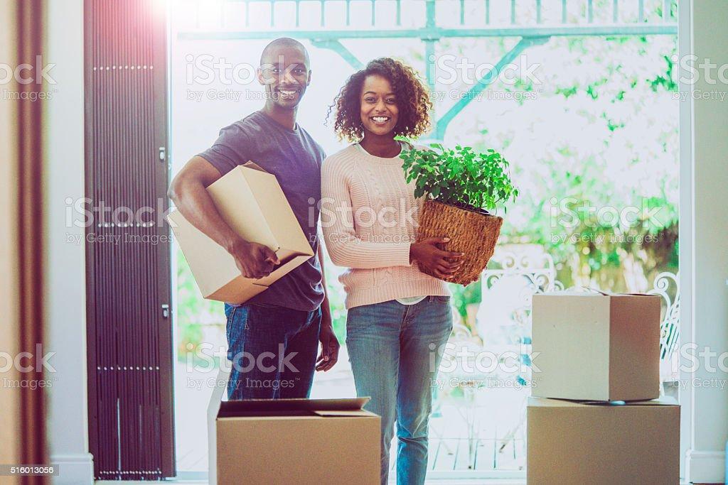 Portrait of happy couple moving house stock photo