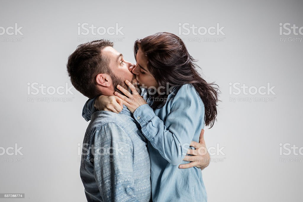 Portrait of happy couple on gray background stock photo