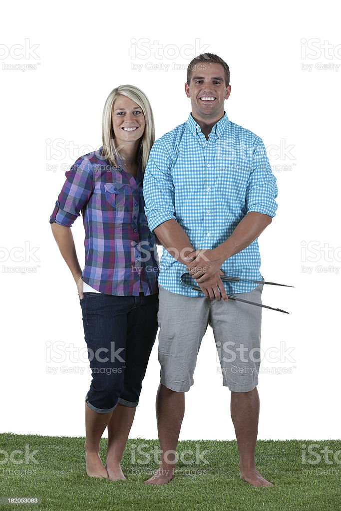 Portrait of happy couple standing in a lawn stock photo