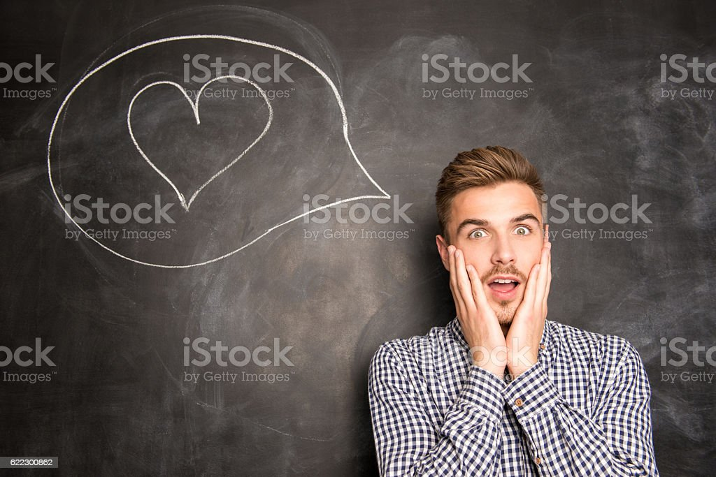 Portrait of happy cute young boy, fell in love stock photo