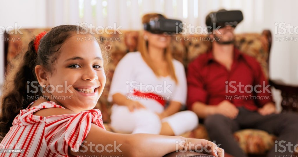 Portrait Of Happy Daughter And Parents Playing Virtual Reality stock photo