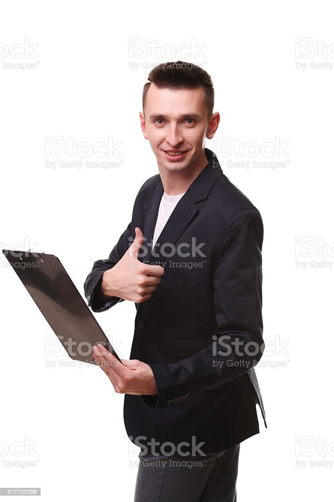 Portrait of happy delivery man gesturing thumbs up while showing royalty-free stock photo