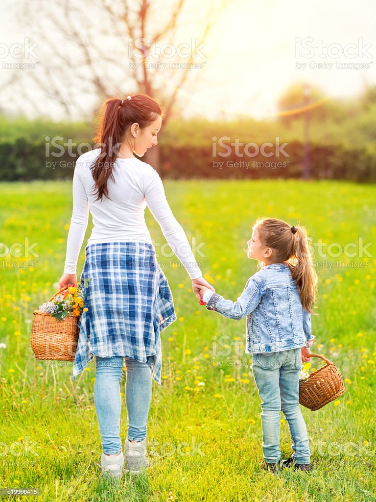 Portrait of happy family holding hands stock photo