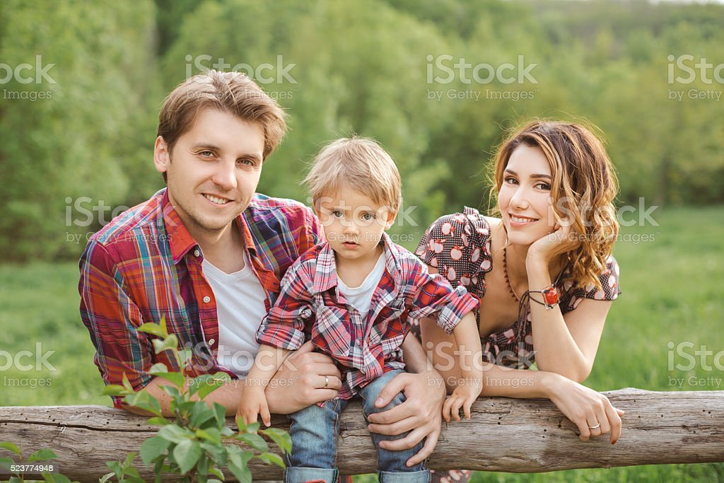 Portrait of Happy Family in a Park stock photo