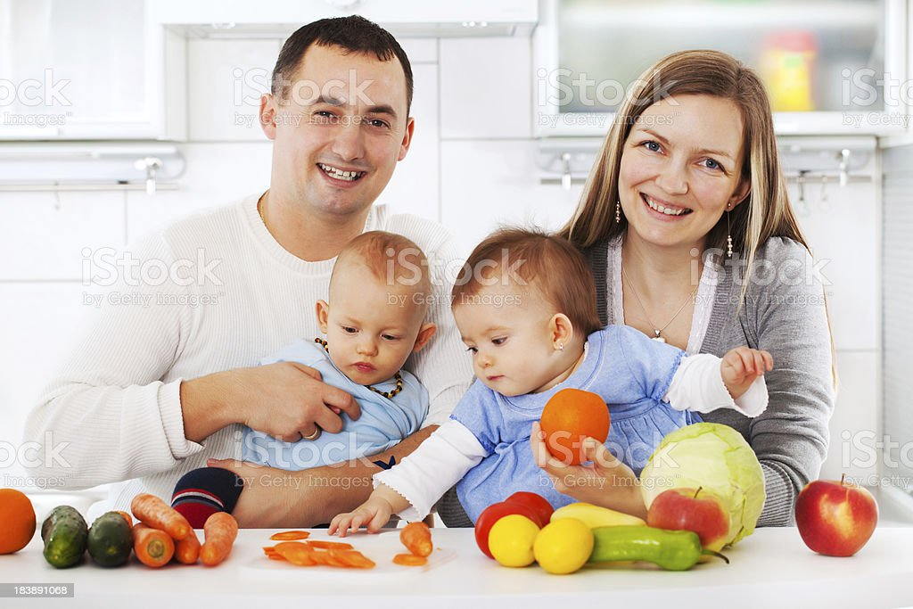 Portrait of happy family in the kitchen. royalty-free stock photo