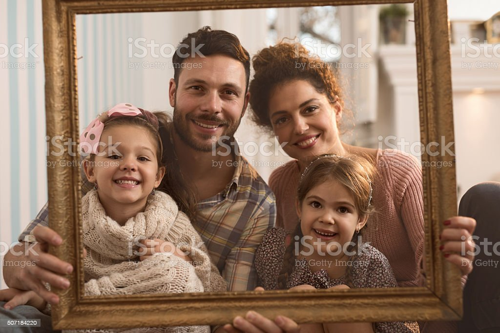 Portrait of happy family looking at the camera. stock photo