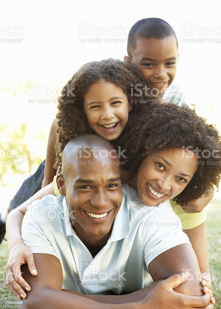 Portrait of Happy Family Piled Up In Park stock photo