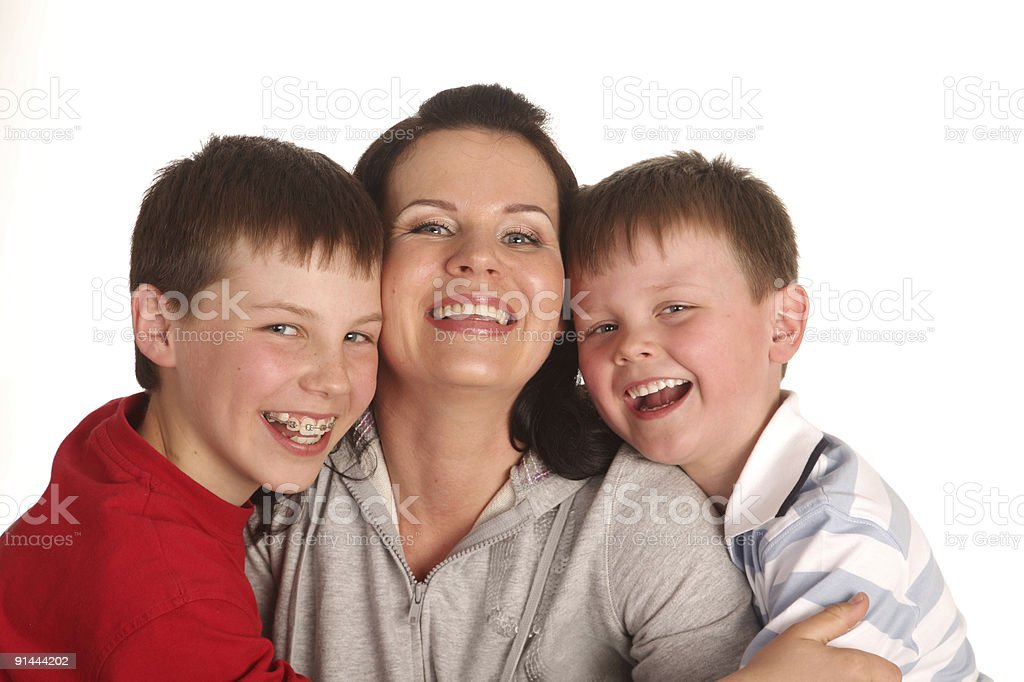 Portrait of happy family: two laughing sons and their mother. royalty-free stock photo
