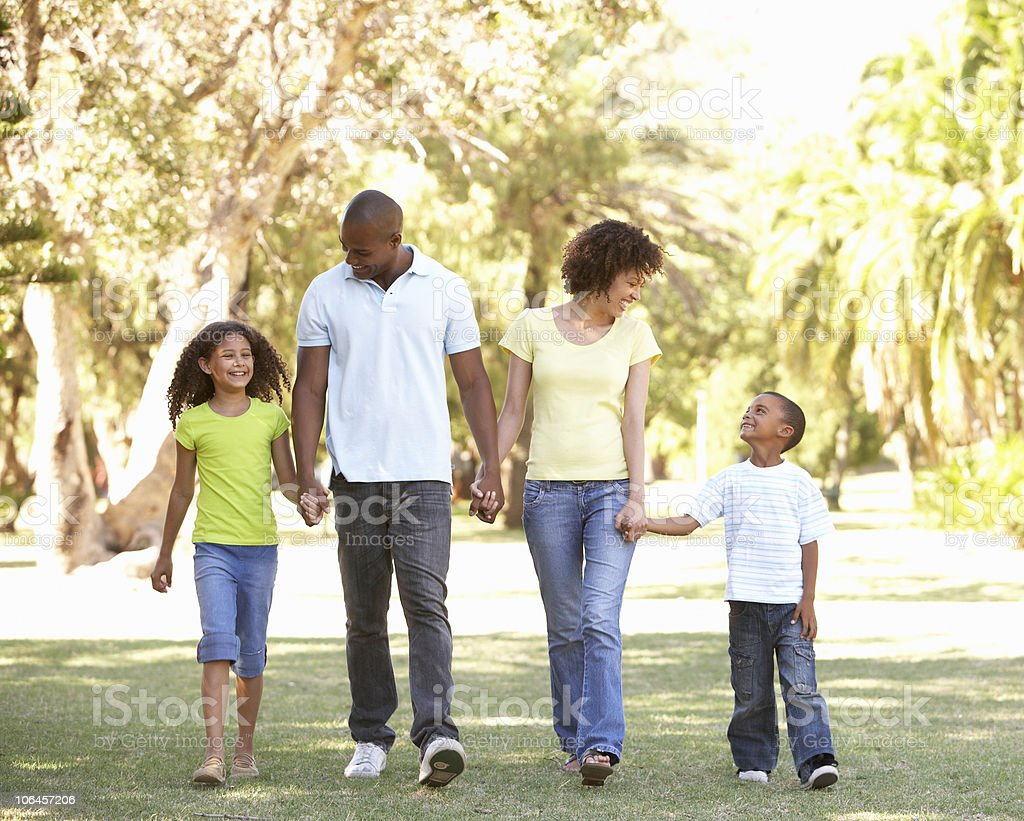Portrait of Happy Family Walking In Park stock photo