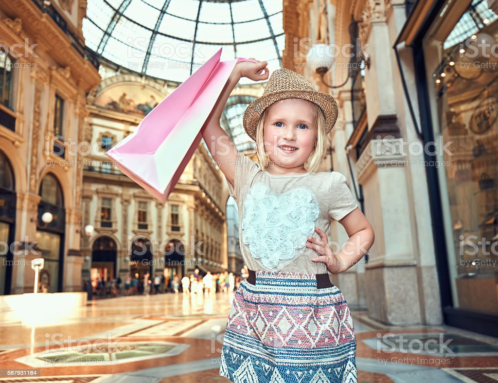 Portrait of happy fashion girl with shopping bag in Galleria stock photo