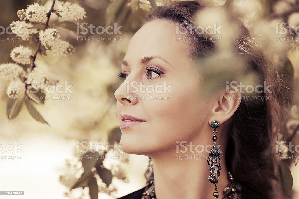 Portrait of happy fashion woman on nature stock photo