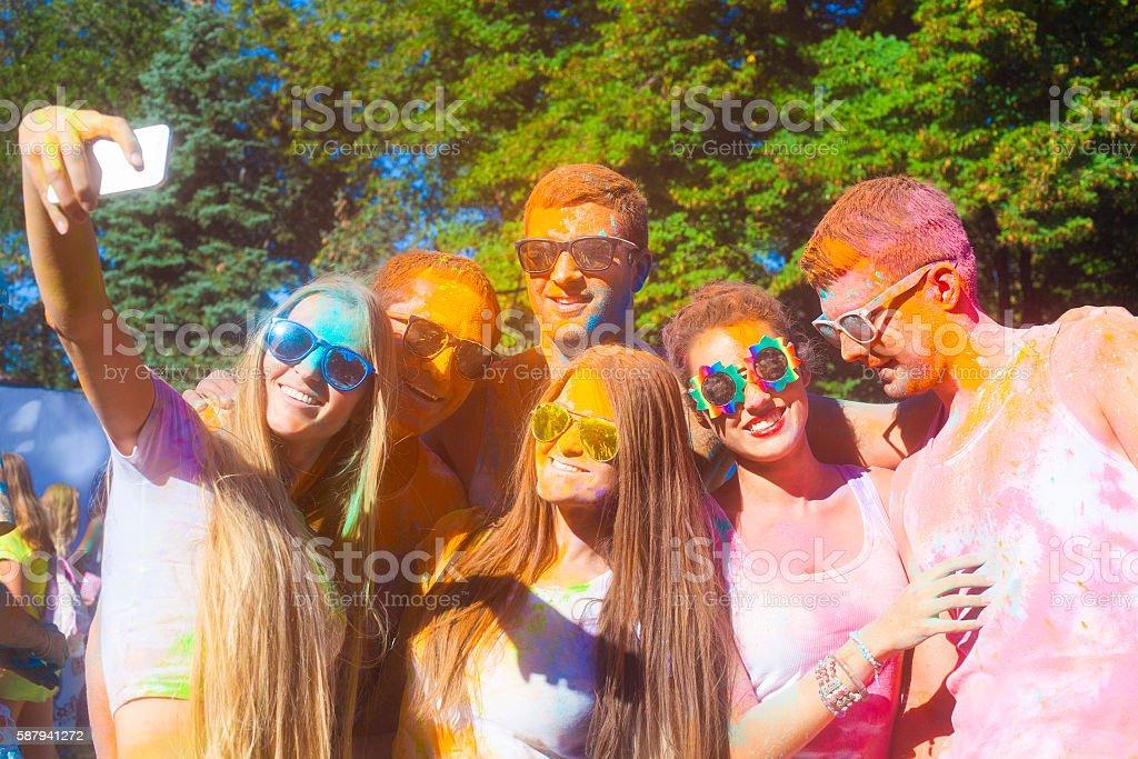 Portrait of happy friends on holi color festival stock photo
