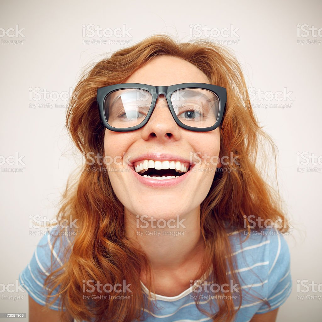 Portrait of happy funny young woman with black glasses. stock photo