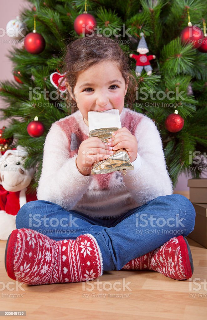 Portrait of happy girl eating chocolate stock photo