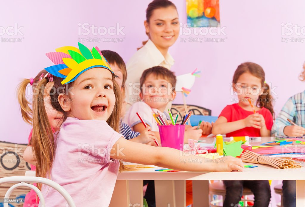 Portrait of happy girl in early developing class stock photo