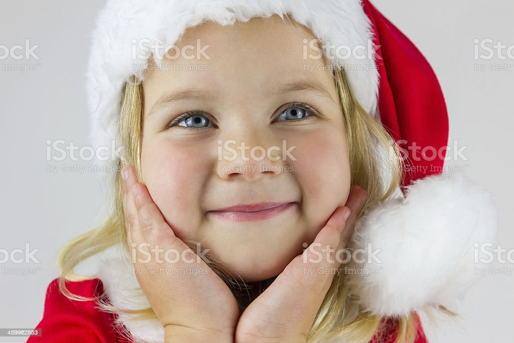 Portrait of  happy girl in red new year cap royalty-free stock photo