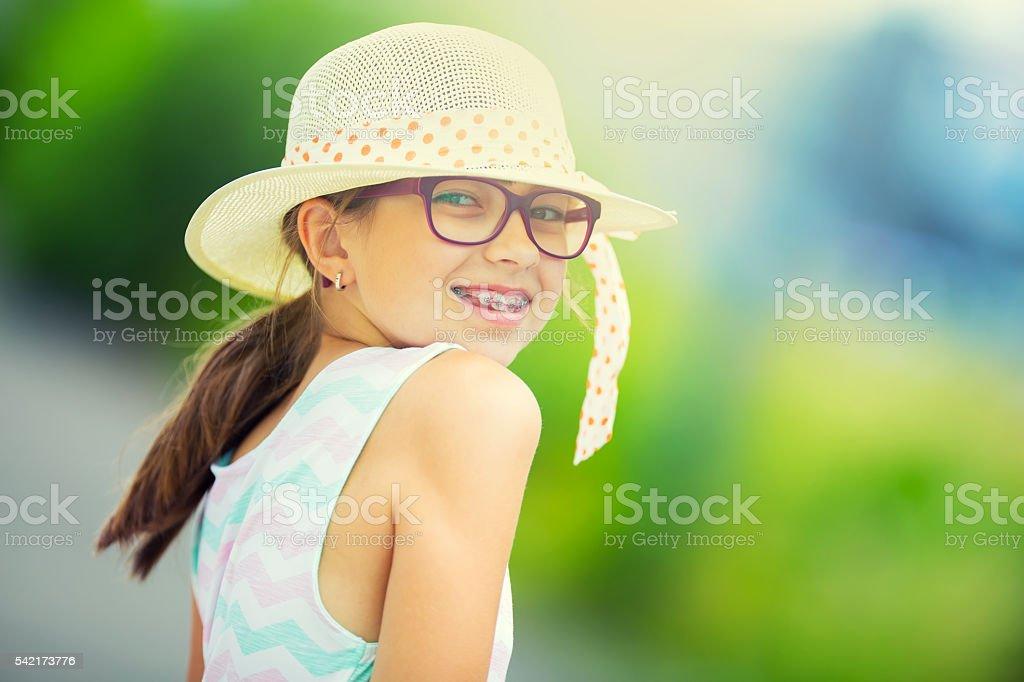 Portrait of Happy girl teen pre teen. Girl with glasses. stock photo