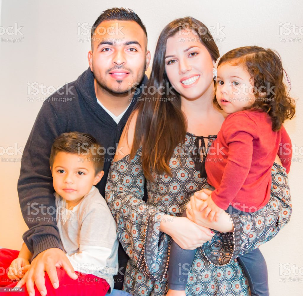 Portrait of Happy Hispanic Family stock photo