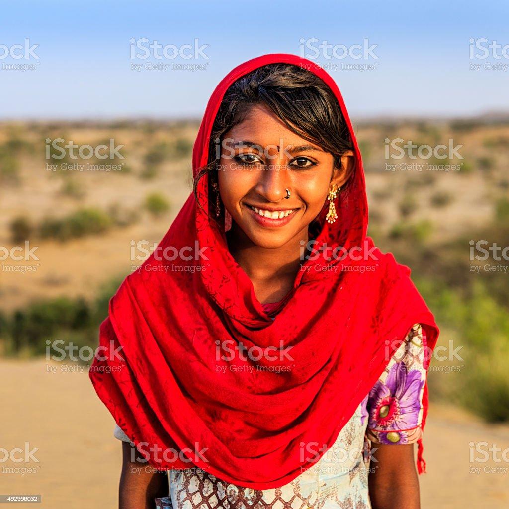Portrait of happy Indian girl in desert village, India stock photo