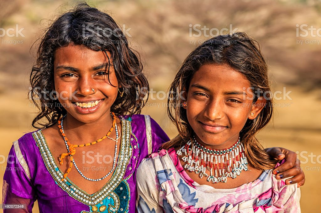 Portrait of happy Indian girls in desert village, India stock photo