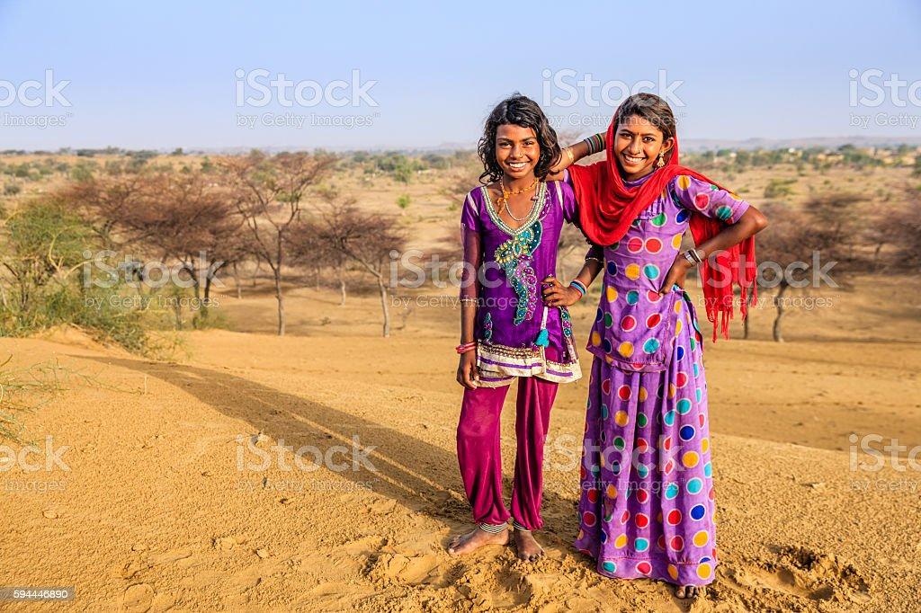 Portrait of happy Indian girls in desert village, India stock photo