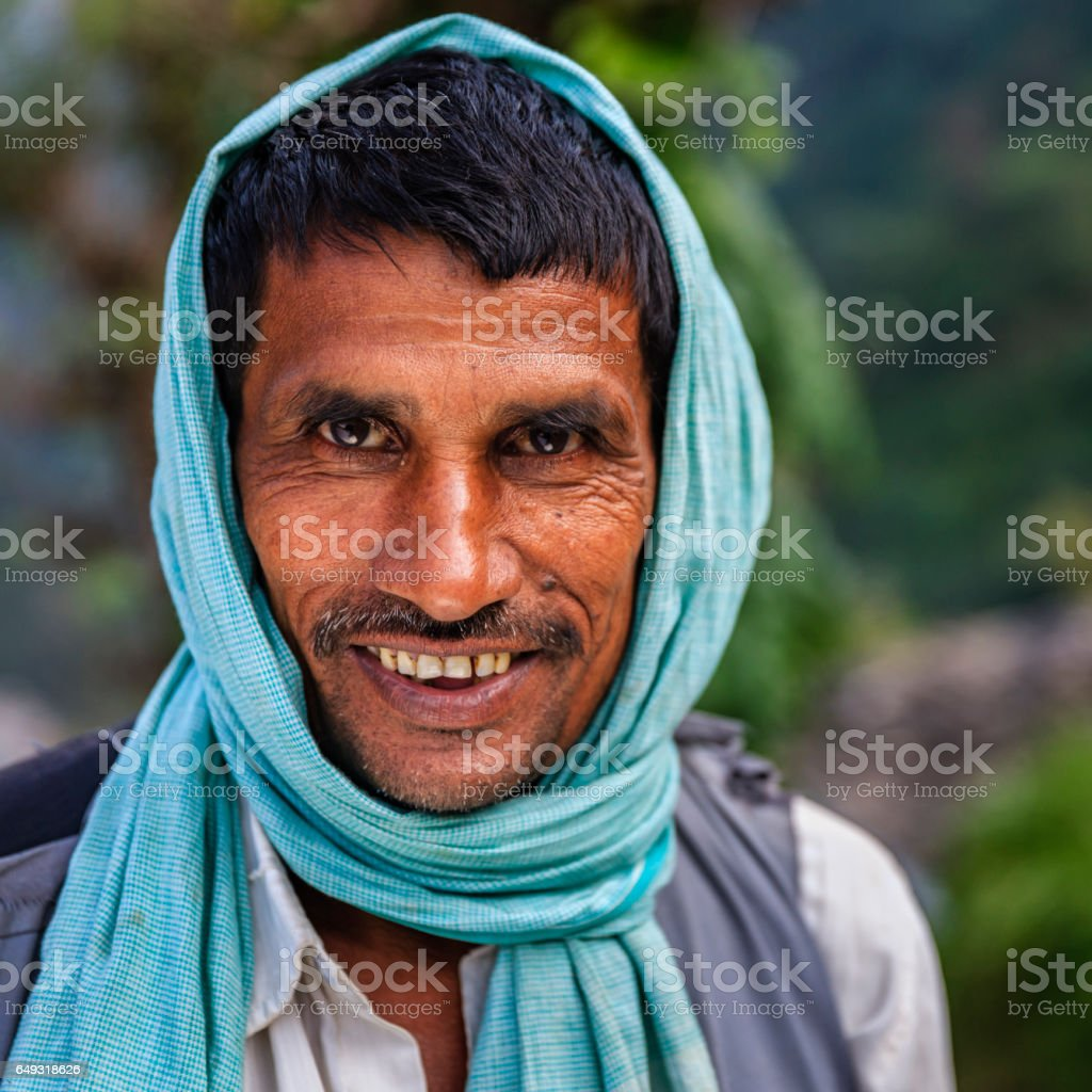Portrait of happy Indian man in Annapurna Conservation Area stock photo