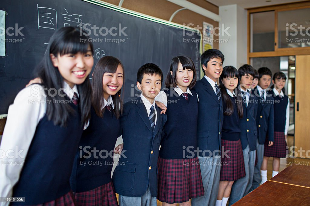 portrait of happy japanese students in the classroom stock