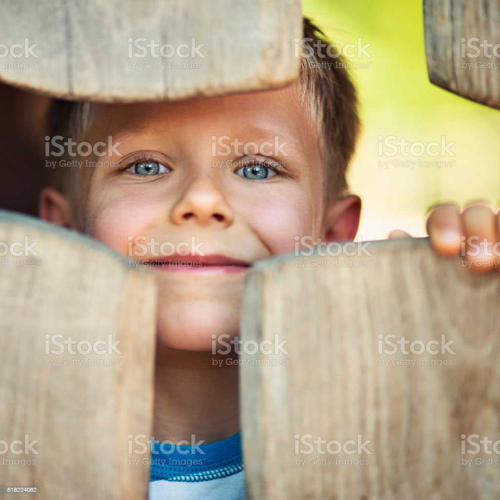 Portrait of happy little boy in the playground stock photo