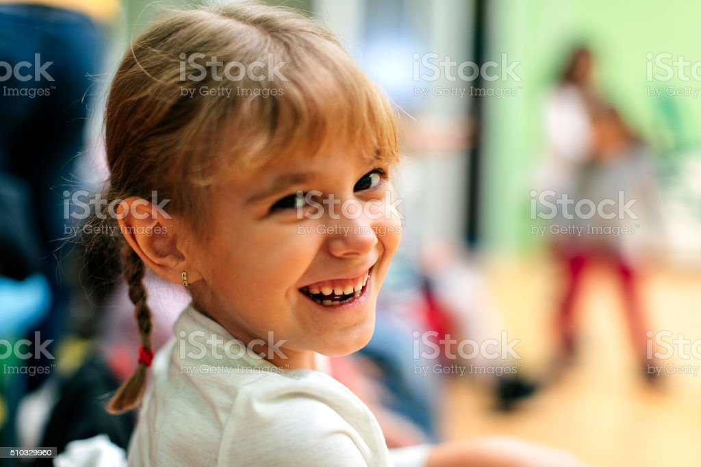 Portrait of Happy Little Girl in kindergarten stock photo