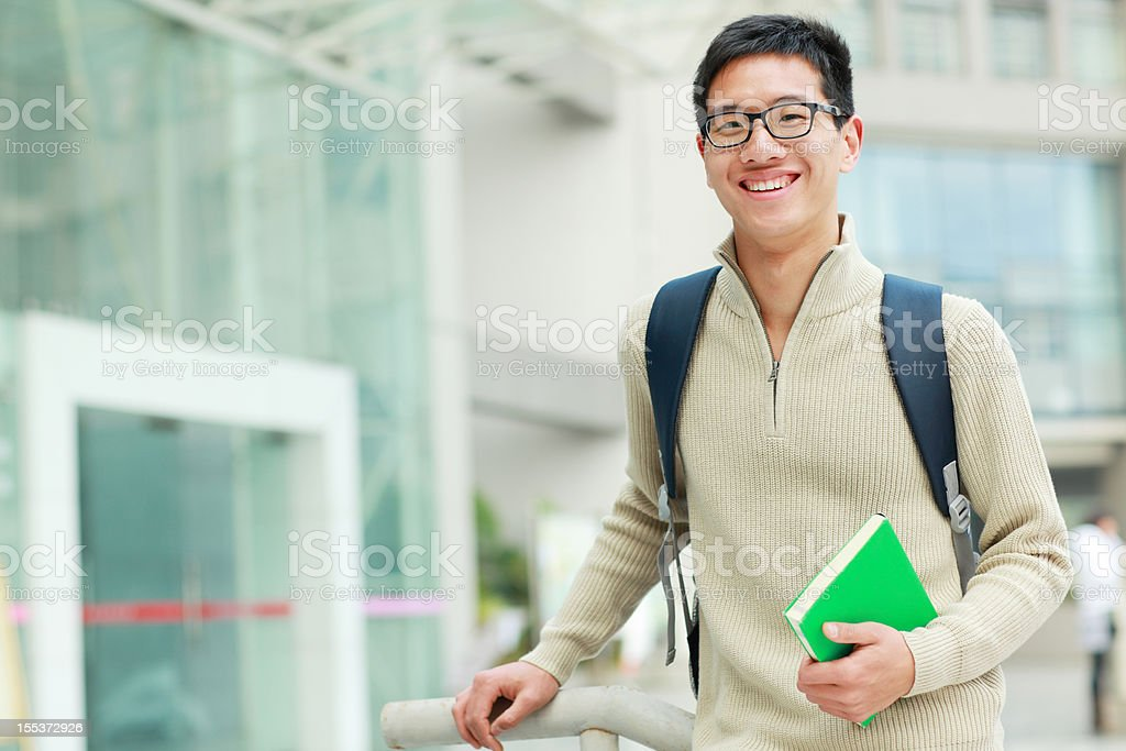 portrait of happy male college student looking royalty-free stock photo