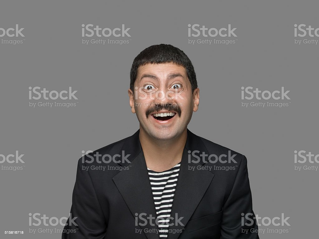 Portrait of happy man looking at camera stock photo