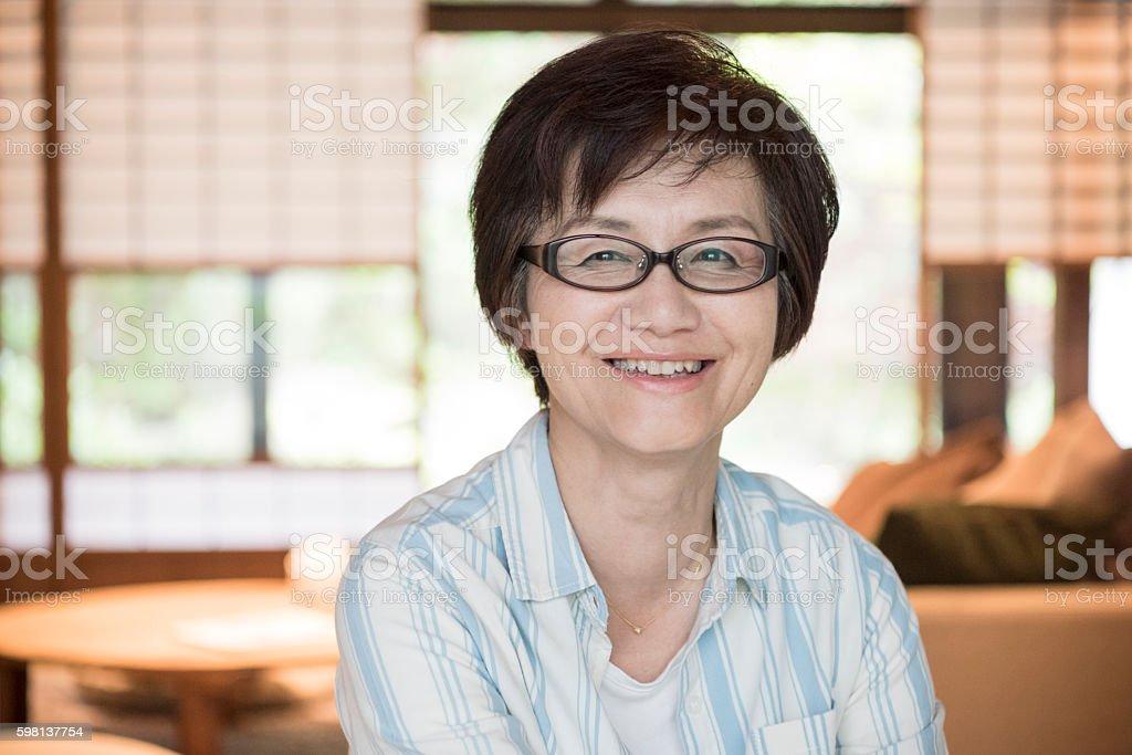 Portrait of happy mature Japanese woman stock photo