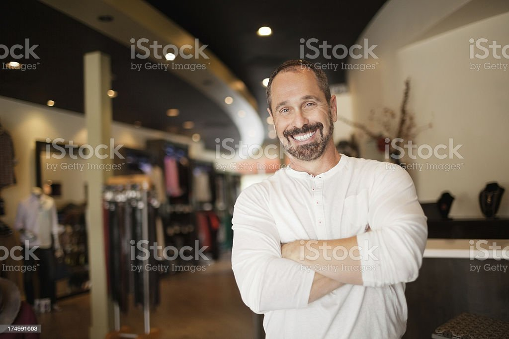 Portrait of happy mature male clothing store owner royalty-free stock photo