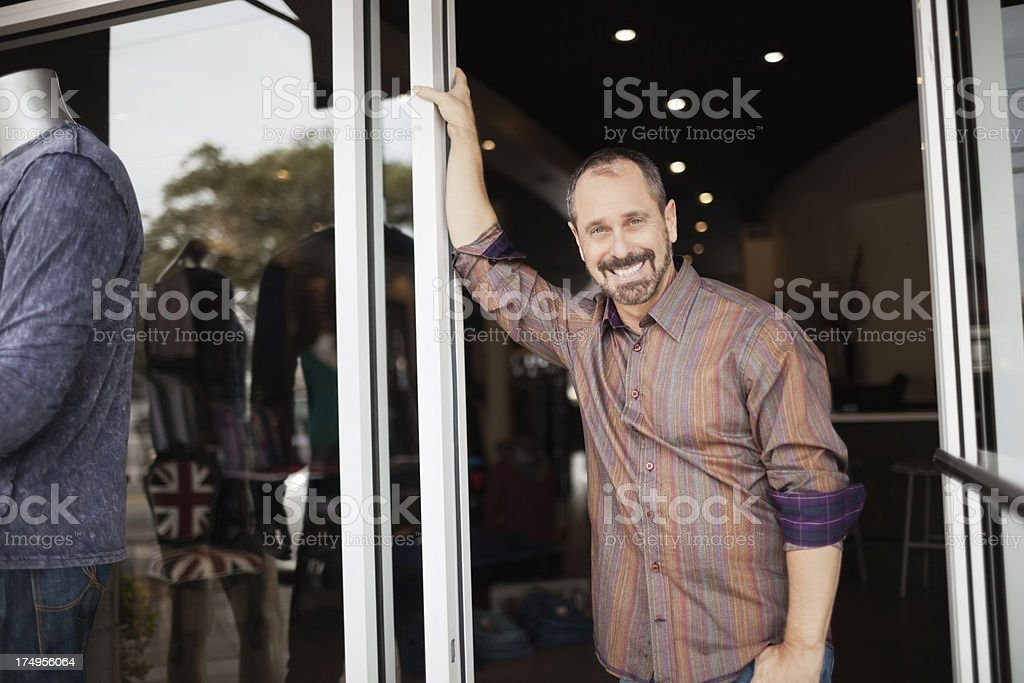 Portrait of happy mature male store owner standing royalty-free stock photo