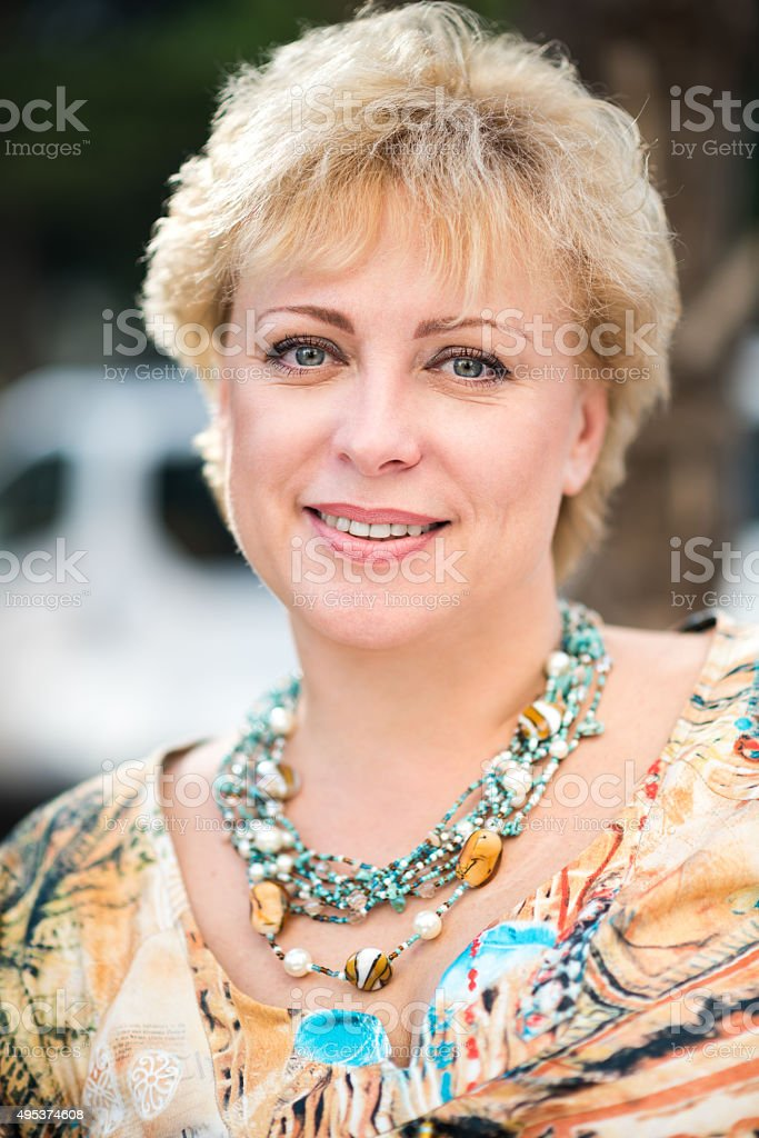 portrait of happy mature woman stock photo