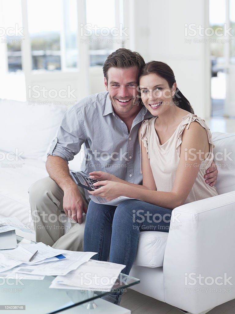 Portrait of happy mid adult couple with home finances royalty-free stock photo