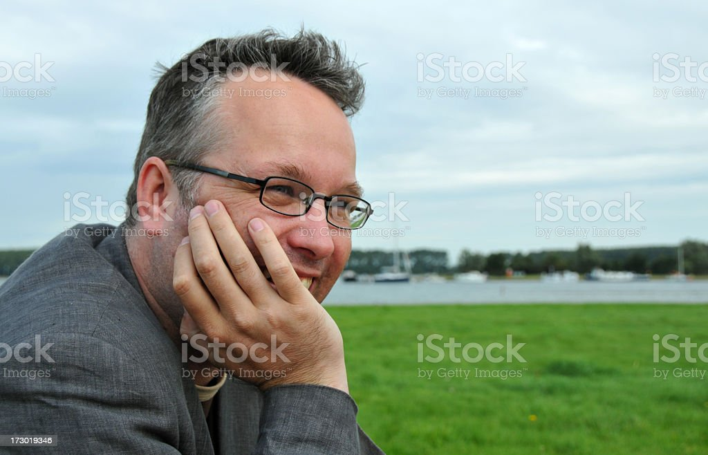 Portrait of happy Mid adult man relaxing at a lake royalty-free stock photo